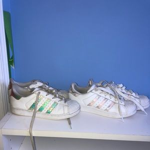 2 pairs of adidas superstar sneakers in kids sizes